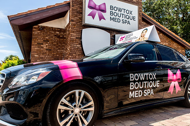 Bowtox Boutique storefront and wrapped Mercedes